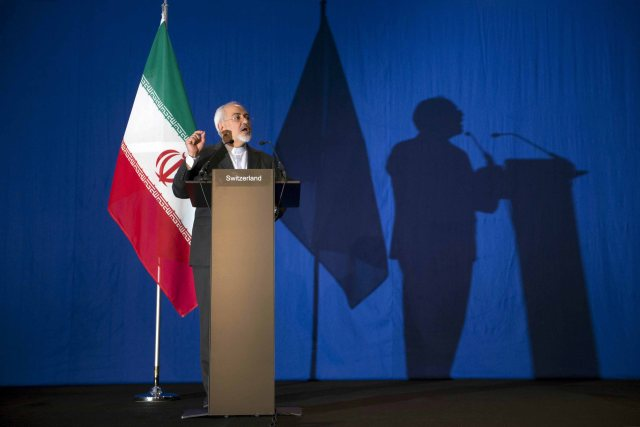 Iran's Foreign Minister Javad Zarif gestures as he speaks during a news conference at the Swiss Federal Institute of Technology in Lausanne (Ecole Polytechnique Federale De Lausanne) on April 2, 2015, after Iran nuclear program talks finished with extended sessions. Iran and world powers reached a framework agreement on Thursday on curbing Iran's nuclear programme for at least a decade after eight days of marathon talks in Switzerland. The tentative agreement clears the way for talks on a future comprehensive settlement that should allay Western fears that Iran was seeking to build an atomic bomb and in return lift economic sanctions on the Islamic Republic.  REUTERS/Brendan Smialowski/Pool  - RTR4VXH0